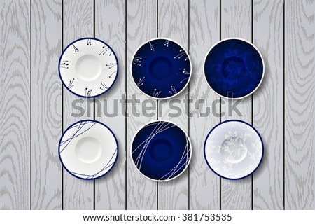 white and blue plate on  wooden white background. Blue plates with flowers ornament - stock vector