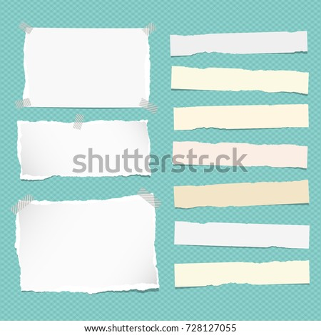 White and yellow ripped strips note, copybook, notebook paper stuck on turquoise background.