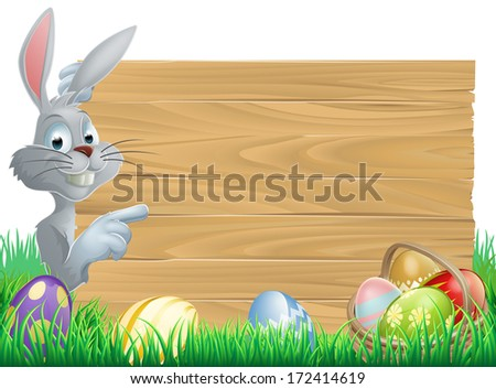 White Easter rabbit bunny peeking round a sign and pointing, chocolate Easter eggs and basket in front  - stock vector
