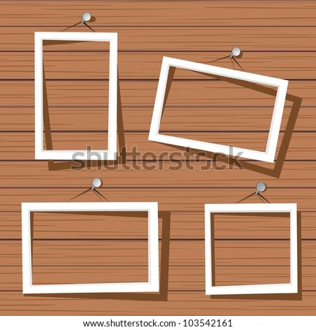 white frames on wooden wall. vector illustration.