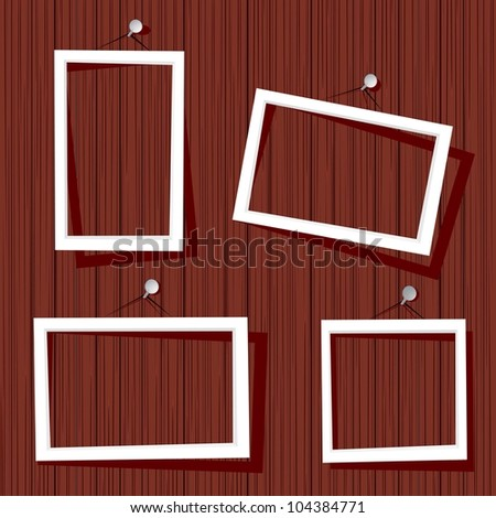 white frames on wooden wall. vector illustration. - stock vector