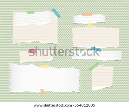 White, light brown, note, notebook, copybook paper strips and sheets stuck with sticky tape on green wavy pattern