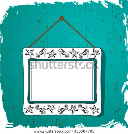 White picture frame with silhouettes of fish hangs on the wall blue.