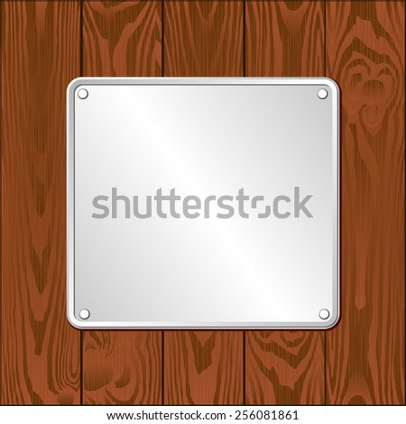 white plaque on dark wooden planks