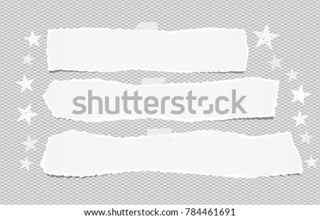 White ripped blank horizontal note paper strips for text or message stuck with sticky tape on gray background with stars