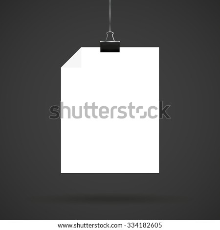 White  sheet of paper with letter clips on a black background