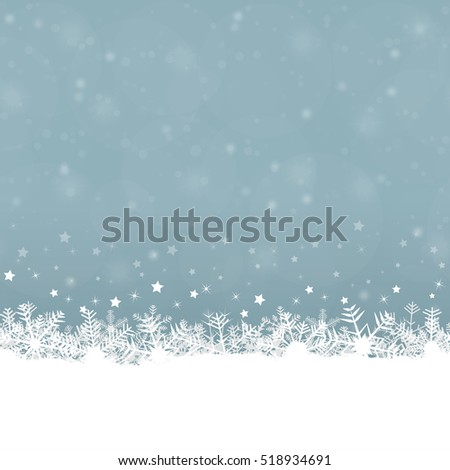 white snow flakes on bottom side and blue colored background