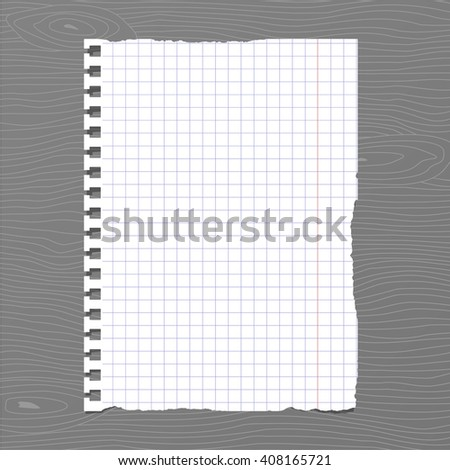 White squared ripped notebook paper sheet is stuck on gray wooden wall, desk
