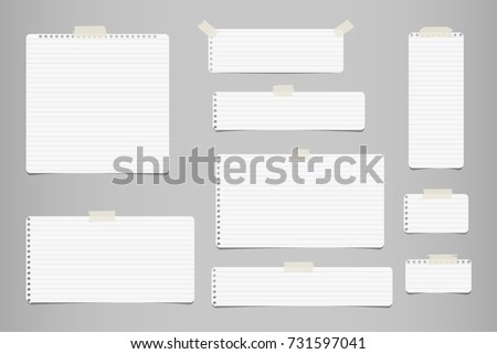 White striped note, notebook paper for message or text stuck with sticky tape on gray background.