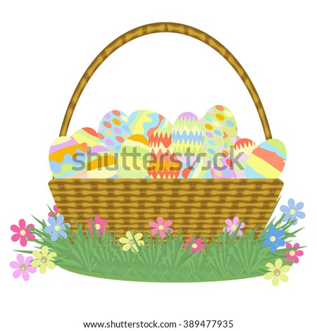 wicker basket with handle is filled with Easter eggs on grass with flowers on a white background