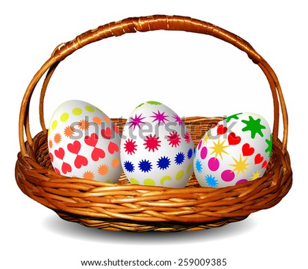 Wicker basket with three painted Easter eggs