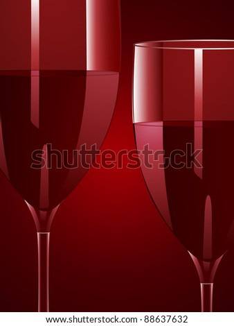 wine glasses with red wine on a red background