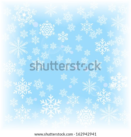 Winter background of falling snowflakes on a blurred background ...