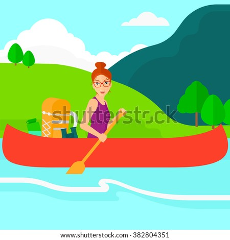 Woman canoeing on the river.