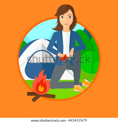Woman kindling campfire on the background of camping site with tent. Tourist relaxing near bonfire. Vector flat design illustration in the circle isolated on background. - stock vector