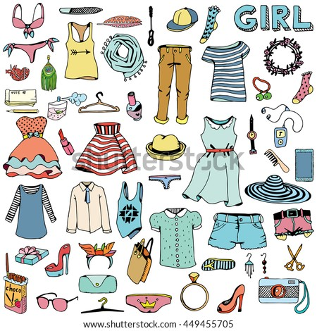 Women clothes and accessories. Hand drawn doodle.