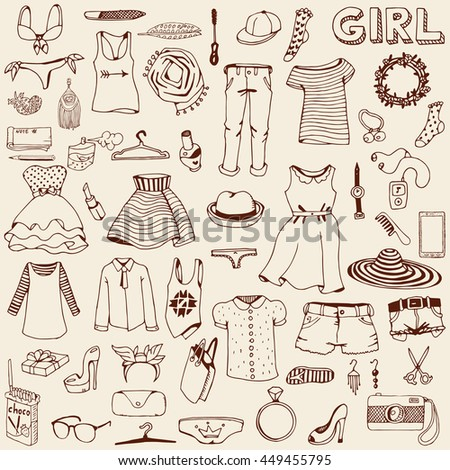Women clothes and accessories. Hand drawn doodle. - stock vector