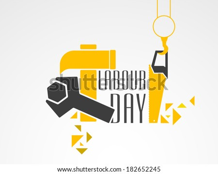 World Labour Day concept with working tools, wrenches and hammer with stylish text on grey background.