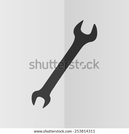 Wrench vector icon. Effect of folded paper. Flat design - stock vector