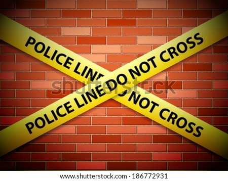 Yellow police line tape on a brick wall.
