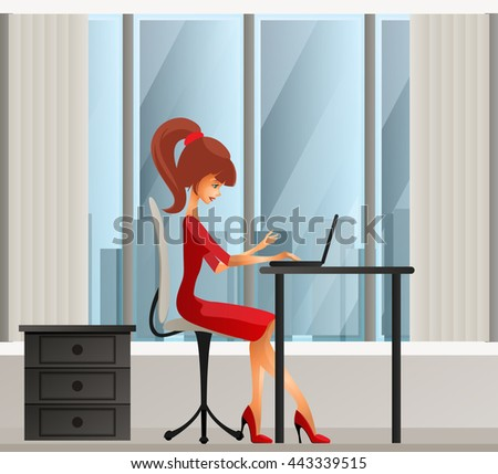 Young secretary or business woman sitting behind laptop