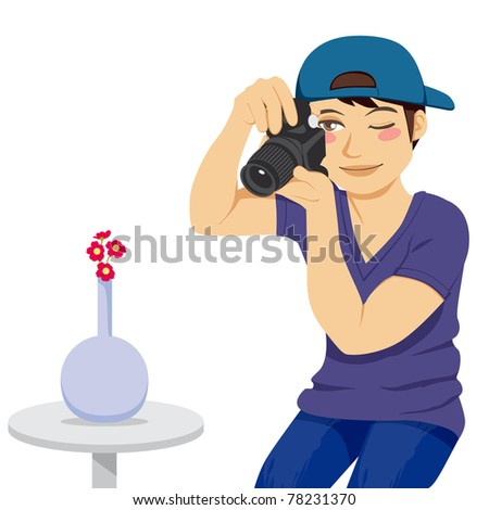 Young stock photographer taking a photo of red flowers on vase isolated on white